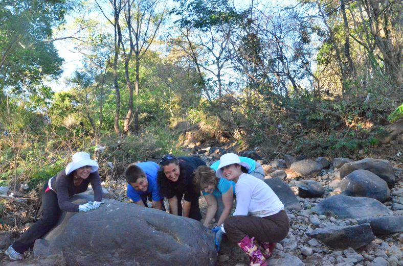 Picking rocks in the river for the house foundation... having some fun doing it