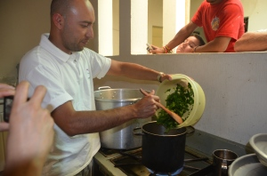 Pedro demonstrating how to cook with Chaya as part of the Nutritional education class.