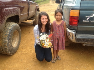 Melissa and her welcome gift of flowers from a little girl in El Salitrillo.
