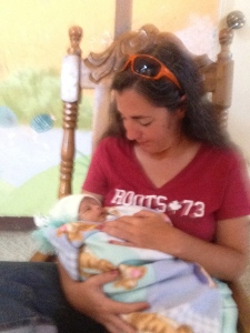 Me feeding baby Jose…. Rest in Peace little one…